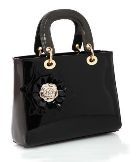 Túi xách cầm tay đính hoa nổi