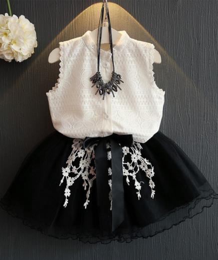 Sét áo trắng chân váy lưới phối hoa rơi