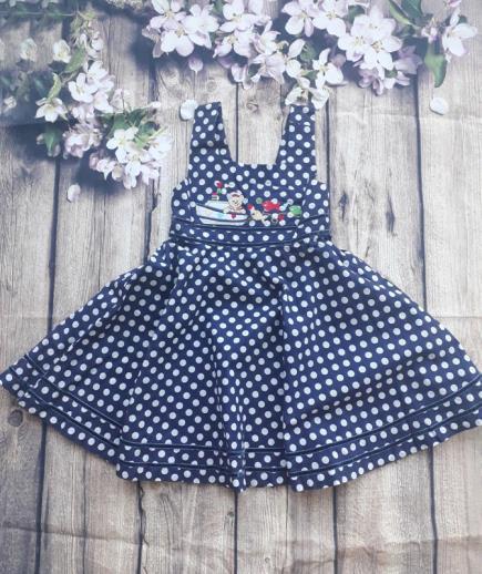 Đầm xòe hai dây chấm bi bé gái